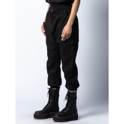 Black linen trousers with two asymmetrical pockets Isso