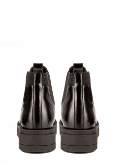 Black leather boots with pointed toe Ginissima